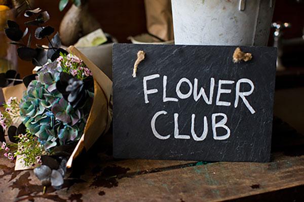 Flower Club written on a chalkboard